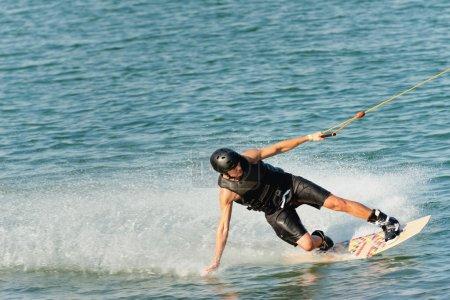 Wakeboarder enjoying ride on lake