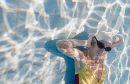 young woman underwater surface