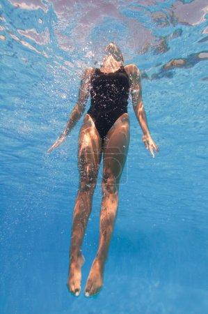 female swimming Underwater