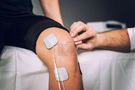Electro stimulation used to treat knee pain