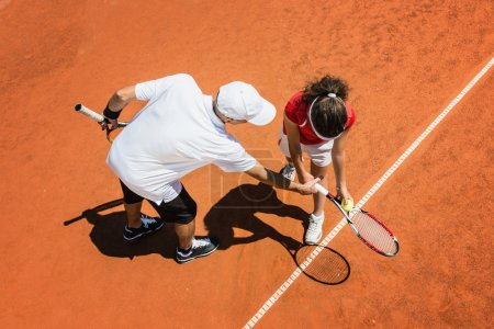 Tennis instructor with Junior player