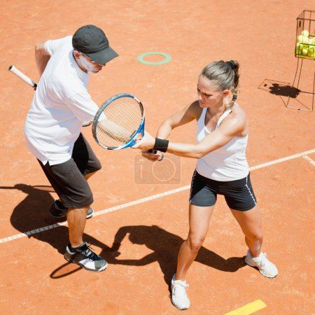 Tennis Instructor working with student