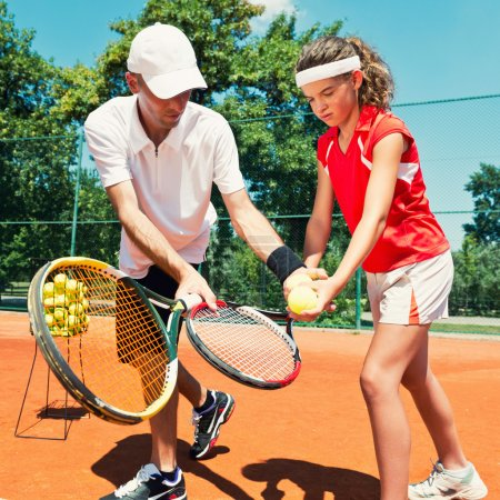 instructor with Junior Tennis player