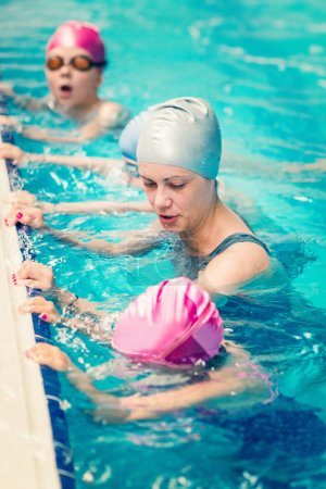 Breathing exercise at swimming class for children