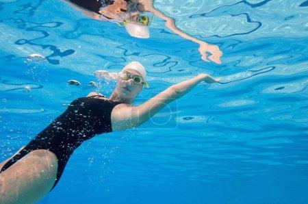 woman swimming backwards