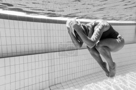female swimmer in fetus pose
