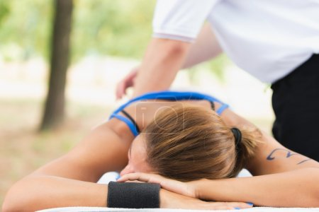 Female athlete on massage table