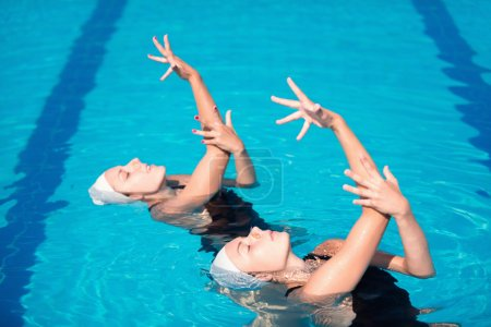 swimming duet dancing with arms up