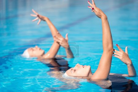 Synchronized swimming duet performing