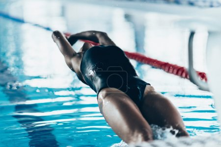 Photo for Backstroke Swimming Start - female swimmer taking off - Royalty Free Image