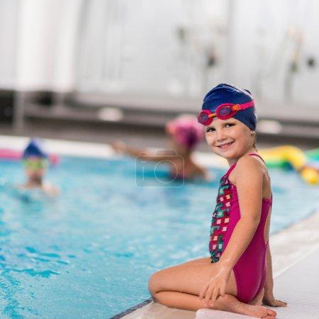 Little girl at poolside