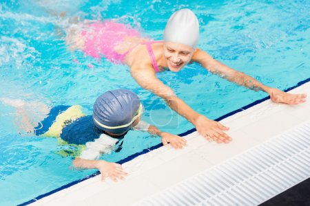 female instructor and little boy in a pool