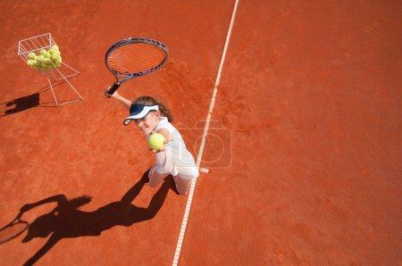 Tennis talent practicing service
