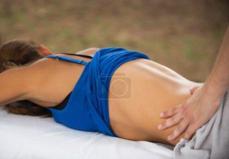Physiotherapist giving back massage