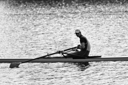 Sportsman resting after rowing