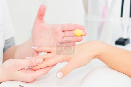 Hand skin cream application, beauty treatment in s...