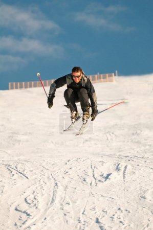 skier jumping on fresh powder