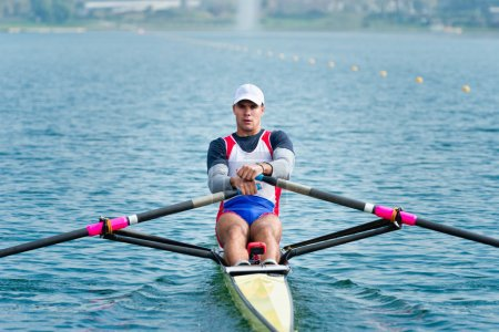 athlete rowing single scull