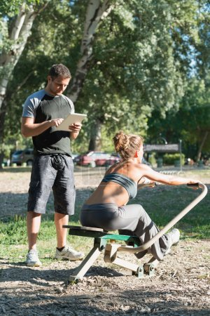 Rowing workout with personal trainer