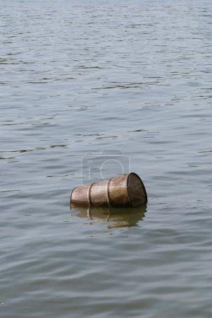 floating oil barrel in river