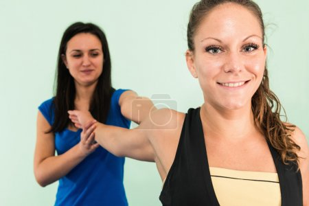 Woman doing  arm stretching exercise