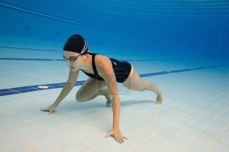 Underwater sprinter in swimming pool lane