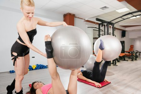 Pilates instructor working with group of women