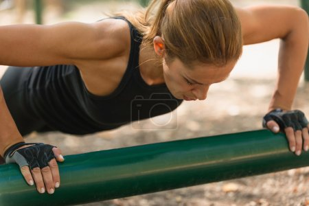 Female athlete doing push-ups