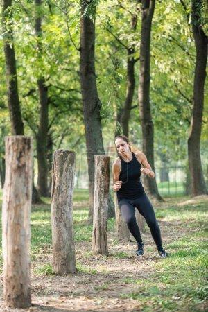 Female athlete on fitness trail