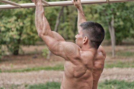 Muscular bulid male exercising