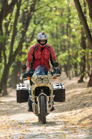 Motorcycle rider in forest
