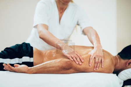 Photo for Physical therapist doing massage of arms. Toned image, selective focus set on hands - Royalty Free Image