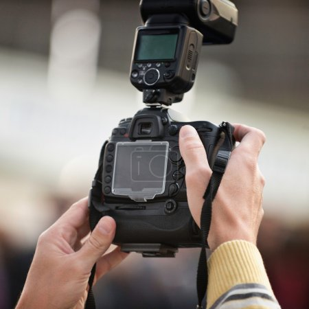 Photo reporter shooting
