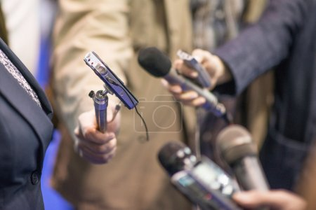 Photo for Media interview - Group of journalists interviewing politician - Royalty Free Image