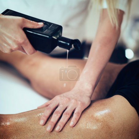 Masseuse using massage oil