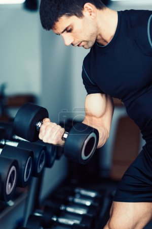 body builder doing biceps exercise