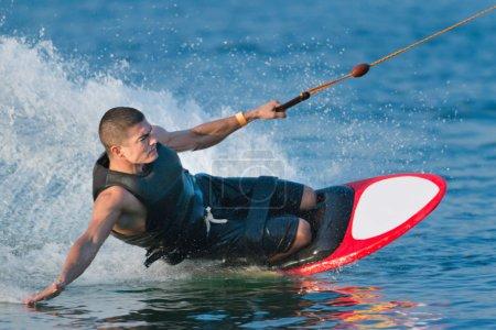 man doing kneeboarding stunt