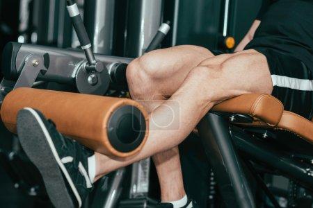 Muscular man exercising in gym