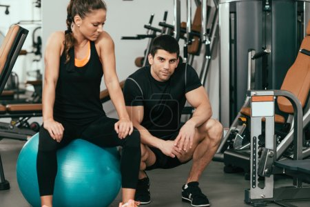 Personal fitness instructors in modern gym