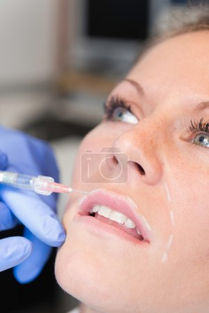 Woman recieving anti-aging injections