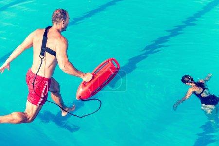 lifeguard jumping towards victim