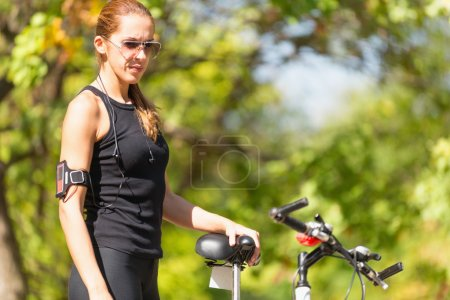 Female biker with bicycle