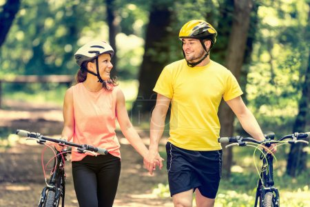 loving couple  walking with bicycles