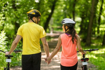 Active Couple walking with bicycles
