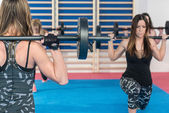 women working out with weights
