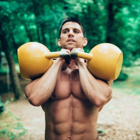 crossfit athlete with kettle bells