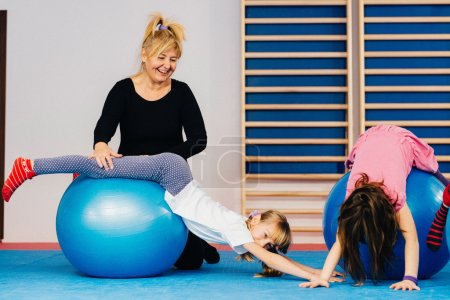 Physical therapist working with little girls