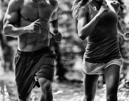 Crossfit athletic couple jogging
