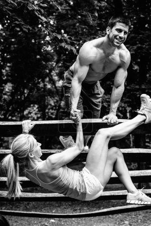 couple exercising at fitness trail