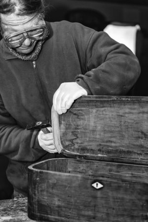 man working with old Furniture